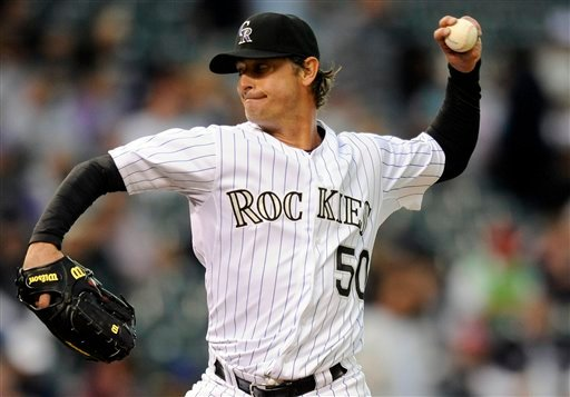 Colorado Rockies starting pitcher Jamie Moyer throws during the second inning of the historic game against the San Diego Padres on Tuesday in Denver.