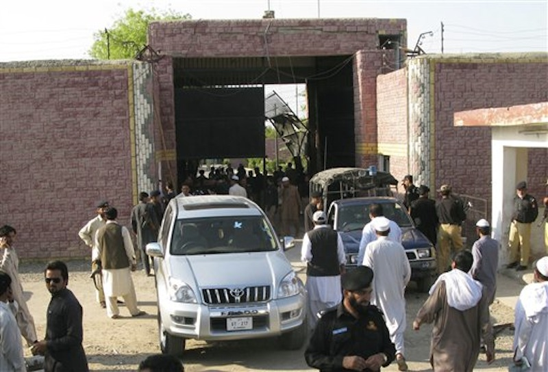 Pakistani security officials visit the central jail in Bannu, 170 kilometer (106 miles) south of Peshawar, Pakistan on Sunday, April 15, 2012. Taliban militants battled their way into the prison on Sunday, freeing close to 400 prisoners, including at least 20 described by police as