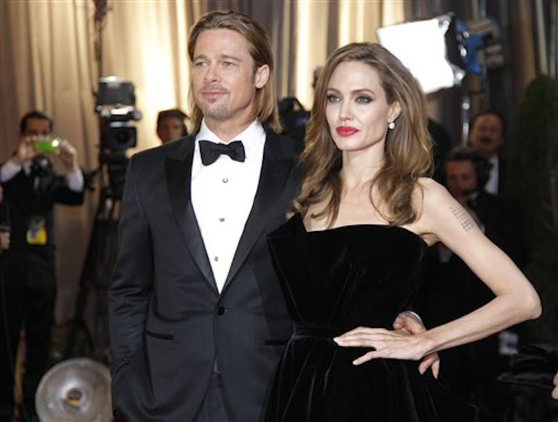 In this Feb. 26, 2012 photo, actress Angelina Jolie, right, and actor Brad Pitt arrive before the 84th Academy Awards in the Hollywood section of Los Angeles. Pitt's manager Cynthia Pett-Dante confirmed their engagement on Friday April 13, 2012. (AP Photo/Amy Sancetta) Award ceremony Oscars Red Carpet Event Academy Awards XLVSTRM12 xoscarhighlights2012x Red carpet
