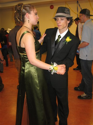 This May 2010 photo released by Karen Schwartz shows Arielle Roberts, left, and Jordan Tomlinson at the prom for Stanley Humphries Secondary School in Castlegar, British Columbia, Canada. Many prom couples want the boy's tie to perfectly match the girl's dres, and Jordan's mother made his green tie from fabric leftover from Arielle's dress. (AP Photo/Karen Schwartz)