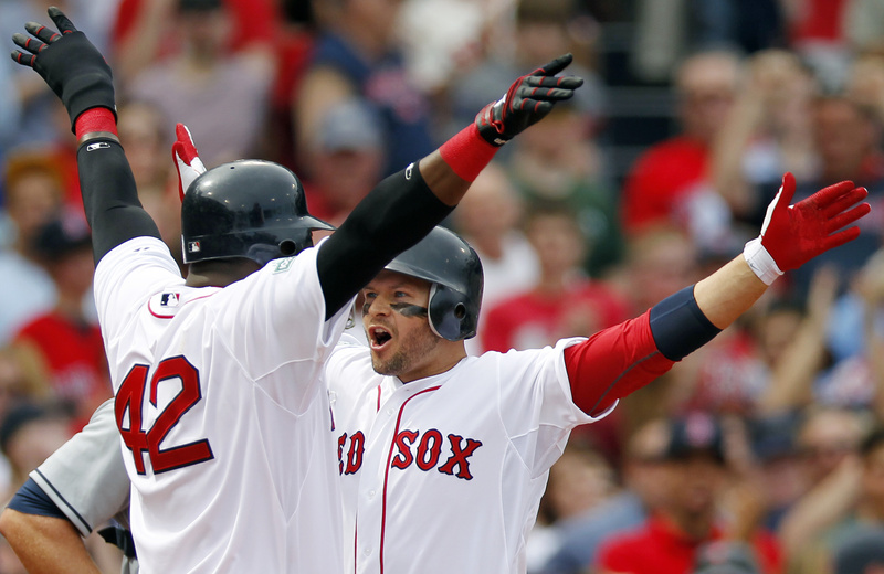 Boston's Cody Ross, right, celebrates his three-run home run with teammate David Ortiz in the second inning of Sunday's game against the Tampa Bay Rays in Boston. The Red Sox won, 6-4.