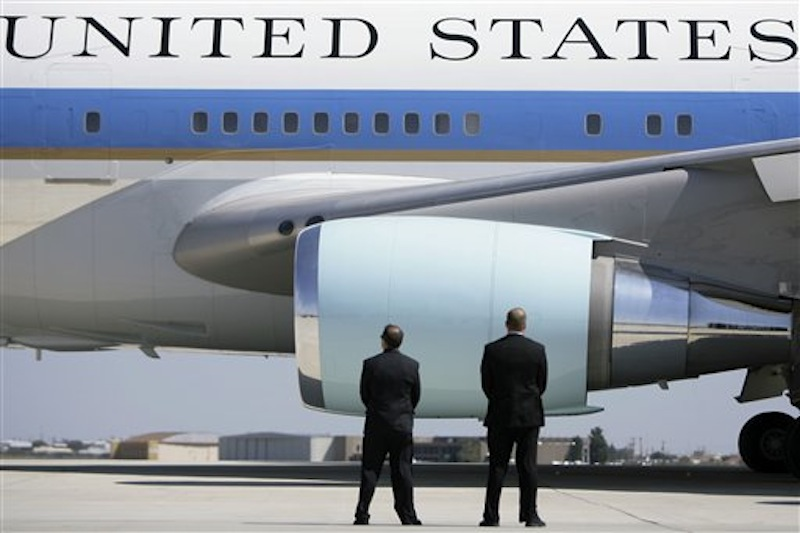In this Saturday, Oct. 4, 2008 file photo, Secret Service agents watch as Air Force One departs Midland International Airport with President Bush and first lady Laura Bush aboard in Midland, Texas. (AP Photo/Matt Slocum)