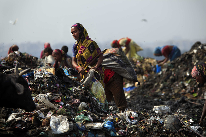 Rag pickers, as they are called, scavenge for food and recyclable materials inside New Delhi's 70-acre, 100-foot-high Ghazipur landfill. Families earn $1 to $2 per day and many live in shanties ringing the dump.