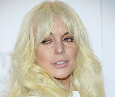 Actress Lindsay Lohan attends amfAR's New York gala benefit at Cipriani Wall Street in New York on Feb. 8. Lohan will portray Elizabeth Taylor in a Lifetime film about her love affair with actor Richard Burton, the network announced Monday.