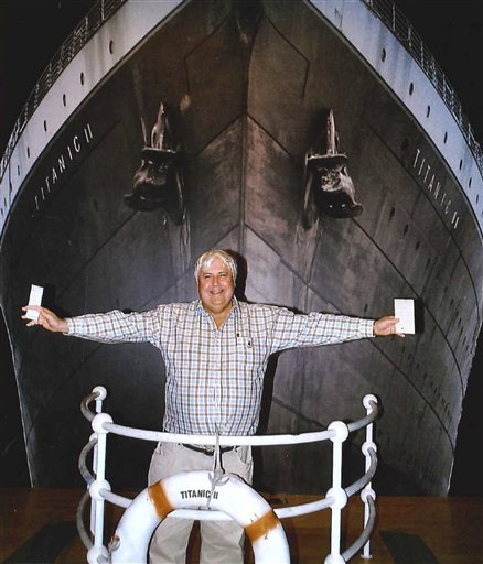 In this April 25, 2012 photo provided by Crook Publicity, Australian billionaire Clive Palmer poses in front of an artist impression of the Titanic ll at MGM Studios in Los Angeles, Ca. Palmer said Monday, April 30, 2012, that he'll build a high-tech replica of the Titanic at a Chinese shipyard and its maiden voyage in late 2016 will be from England to New York, just like its namesake planned. (AP Photo/Crook Publicity)