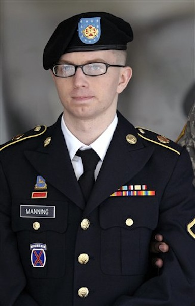 In this March 15, 2012 file photo, Army Pfc. Bradley Manning departs a courthouse in Fort Meade, Md. Manning is accused of engineering the biggest leak of government secrets in U.S. history, including sensitive diplomatic cables and a video where U.S. soldiers shoot civilians from an Apache helicopter. (AP Photo/Cliff Owen)