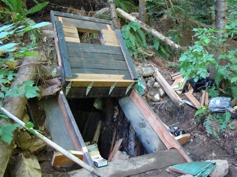This undated photo provided by the King County Sheriff's Department on Friday, April 27, 2012, shows a bunker that deputies say belongs to a man suspected of killing his wife and daughter and holing up for days in the Cascade foothills east of Seattle. (AP Photo/King County Sheriff's Department)