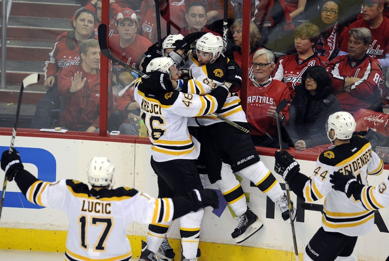 Tyler Seguin scores the winner for Boston in OT Sunday, then gets mobbed by teammates David Krejci, left, and Brad Marchand in Game 6 at Washington. The Bruins fought off elimination and are home for Game 7 Wednesday night.