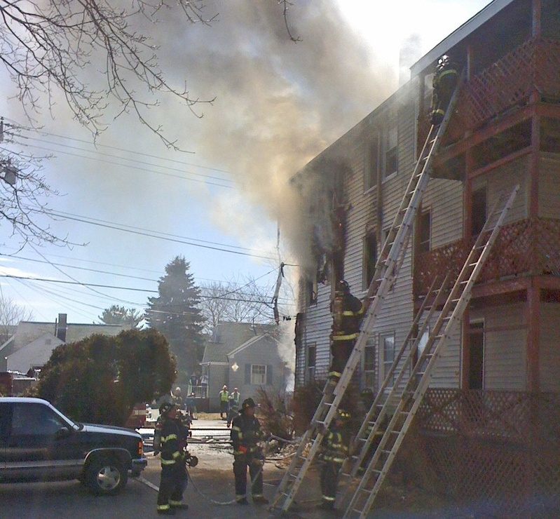 Portland firefighters put out a fire on Walton Street in March 2011. The city manager has called for the first evaluation of the fire department since 1983.