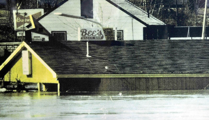 HIGH WATER: This photograph was taken of Bee's Snack Bar in Winslow at the height of floodwater during the flood of 1987. The business survived the flood that swept away seven nearby homes on Lithgow Street.