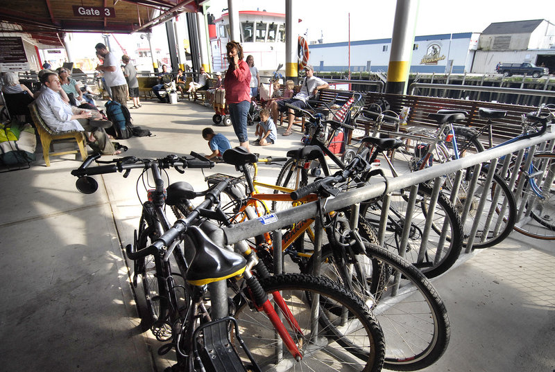 Bicycles await commuters at the Casco Bay Lines terminal on Commercial Street. Biking and walking are becoming more popular ways to get around town.