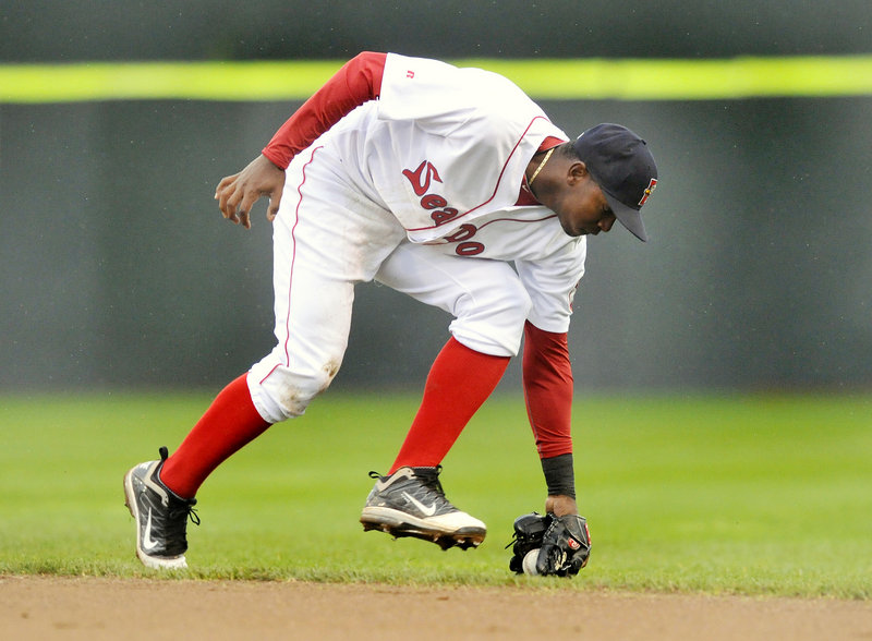 Sea Dogs second baseman Oscar Tejeda prepares fields a ground ball. Tejeda had a home run in Sunday's 4-2 loss to Reading, as Portland remained in last place.