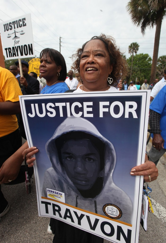 Andre Frison joins thousands of other protesters in a march and rally for slain Florida teenager Trayvon Martin on Saturday in Sanford, Fla.