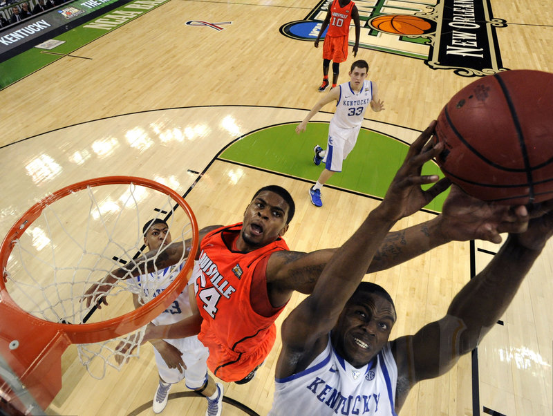 Darius Miller of Kentucky gets positioned to pull down a rebound in front of Chane Behanan of Louisville during Kentucky's 69-61 victory Saturday at the Final Four.