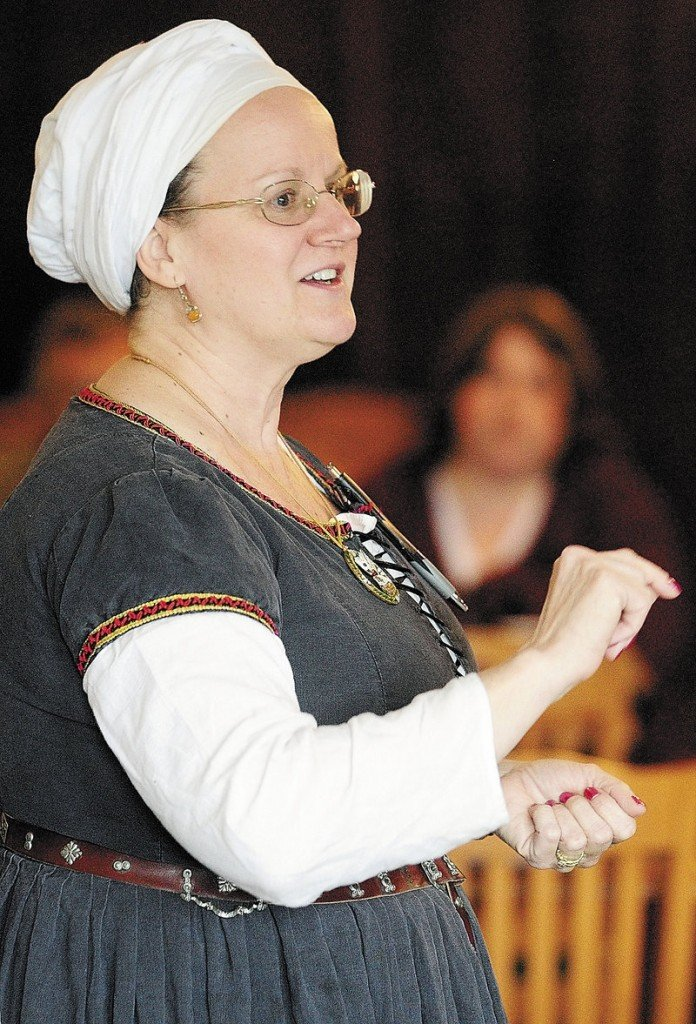 Susan Maebert-Frank, known as Baroness Mistress Suzanne Neuber de Londres, teaches a class during the East Kingdom Brewers' Collegium sponsored by the Society for Creative Anachronism on Saturday in Augusta. Maebert-Frank is leader of the East Kingdom Brewers' Guild and a resident of Long Island.