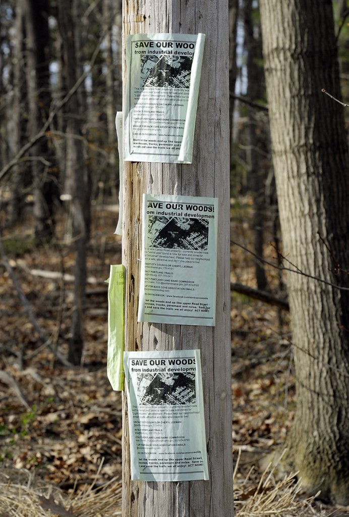 """Neighbors of """"Canco Woods"""" have posted signs to draw attention to the parcel's impending sale and to rally people to help save the neighborhood oasis."""