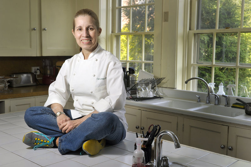 Chef Carmen Gonzalez, above, in the kitchen at The Danforth Inn in Portland, where she is busily preparing for the planned May opening of Carmen at The Danforth. Gonzalez's plans for the summer menu emphasize seafood with a Latin twist.
