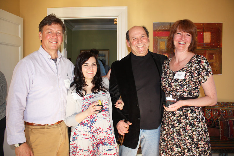 John Williams, executive director of 317 Main Street Community Music Center, bar manager Brittan Pistole, board member Jon Cooper and office manager Fiona O'Grady.