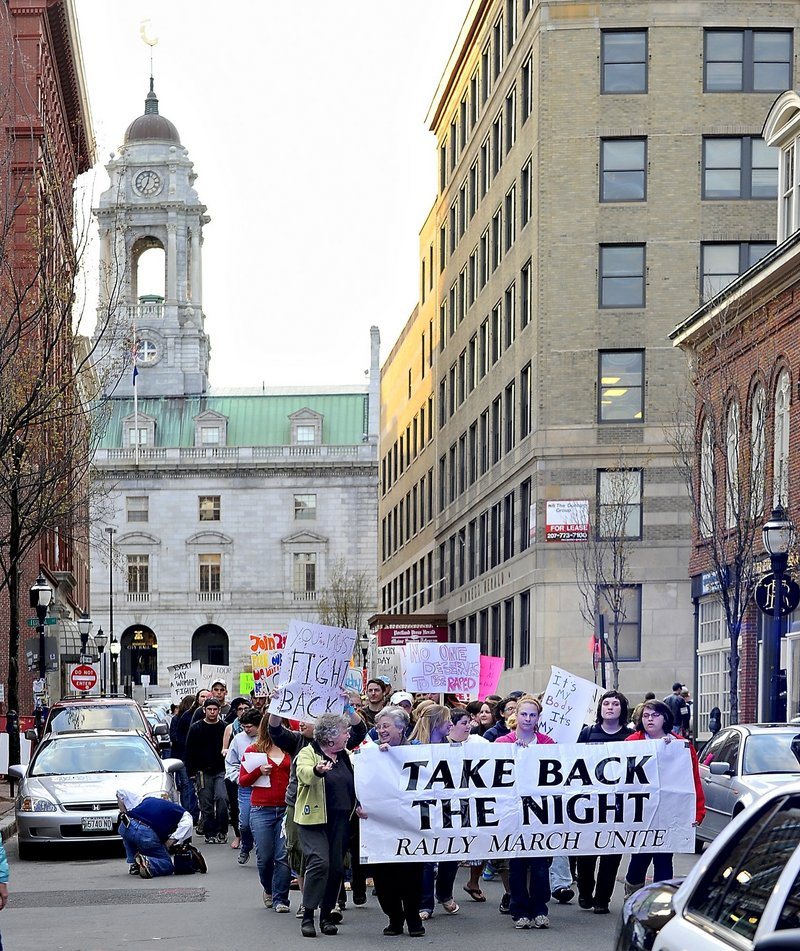 Marchers participate in the 2010 Take Back the Night rally on Exchange Street in Portland. This year's march is April 27.