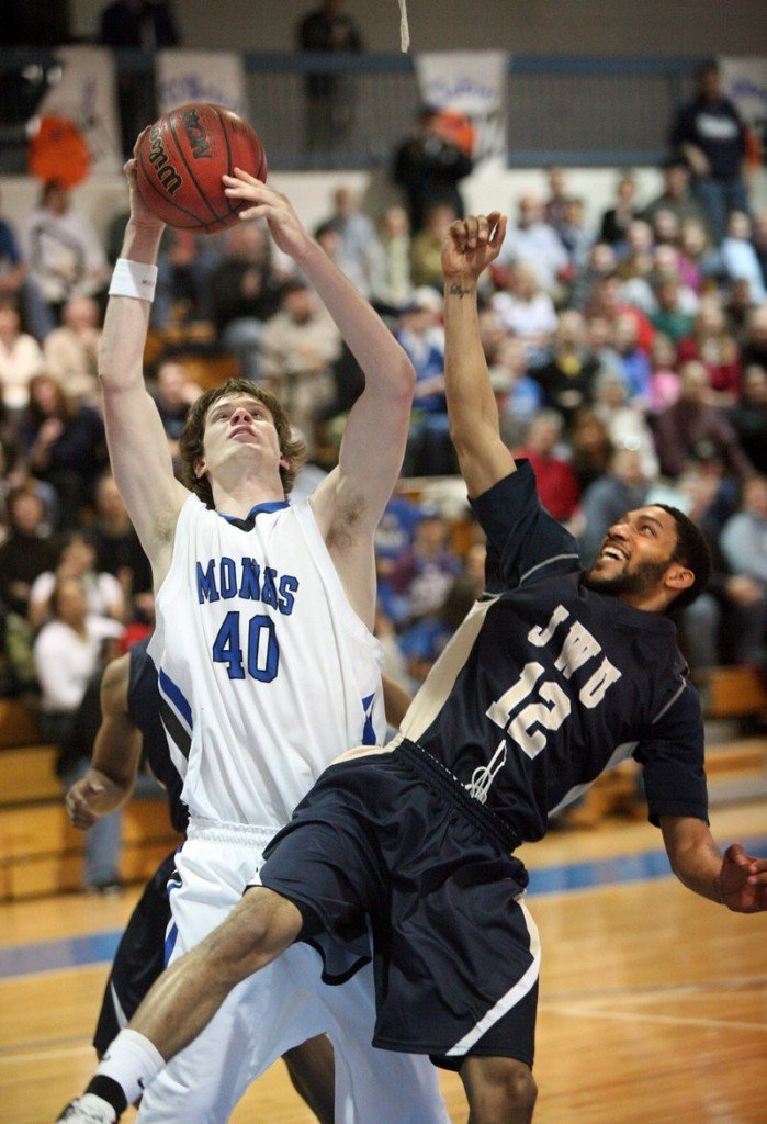 Clark Noonan, left, of Saint Joseph's College in Standish, pulls down a rebound over Darren Faust of Johnson & Wales University in a conference title game last year. Noonan, who was killed in a car crash early Saturday, was remembered by a former coach as a hardworking player who made himself into a star.