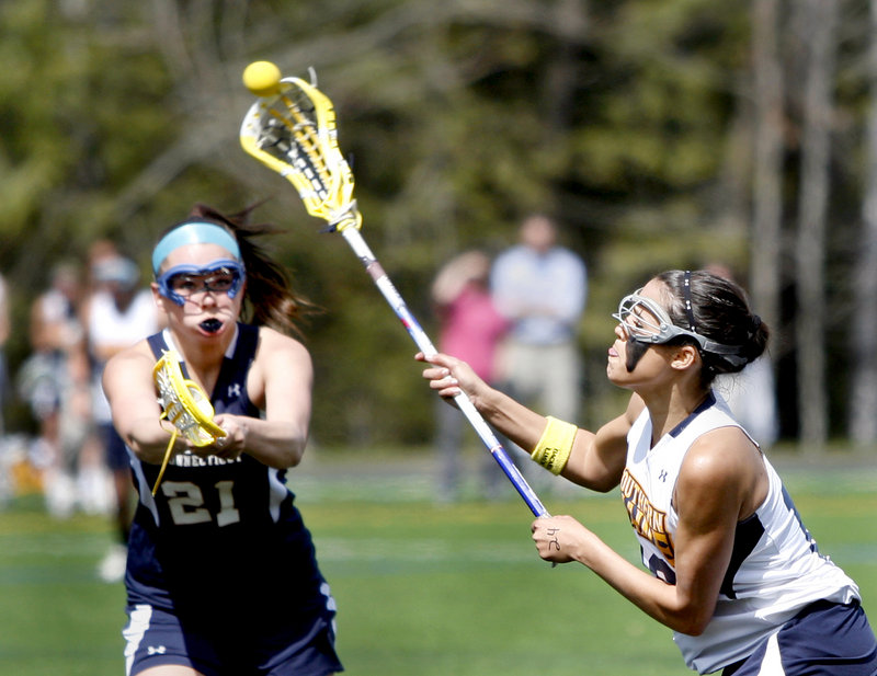 Rosie Fortser of the University of Southern Maine fires a shot as Hyla Costello of Western Connecticut State University tries to defend during Saturday's women's lacrosse game at Gorham. USM won, 16-9.
