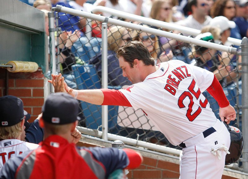 Bryce Brentz returns to the dugout after scoring on a double in the fourth inning Saturday at Hadlock Field. The Sea Dogs beat the Binghamton Mets, 5-3.
