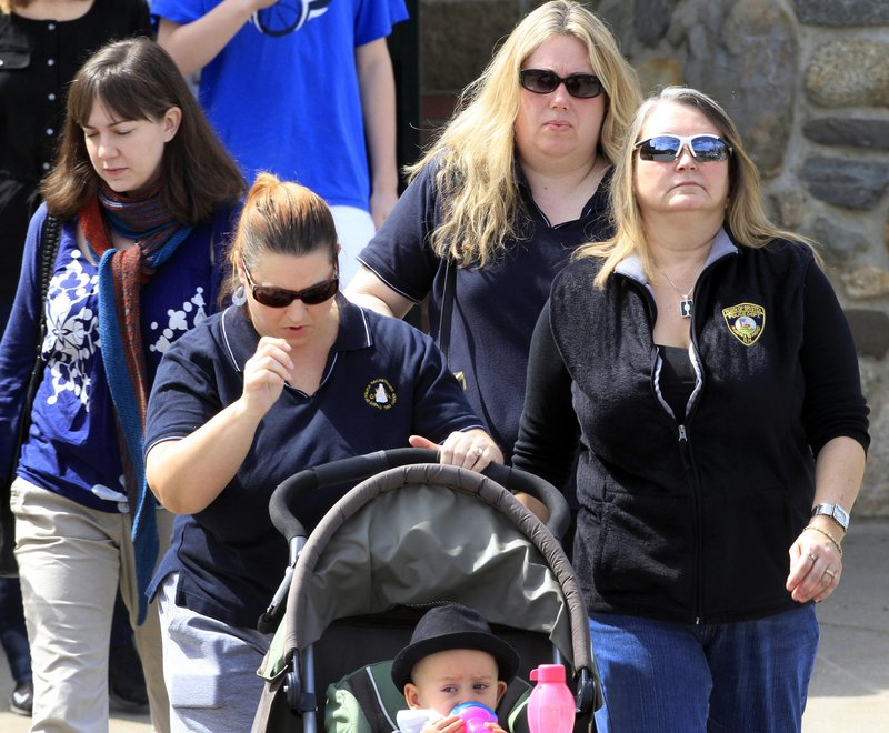 Greenland, N.H., residents leave a memorial service for the town's police chief, Michael Maloney, on Saturday. Days away from his retirement from the seven-member force, Maloney, 48, was killed in a shootout Thursday that also left four police officers from other departments wounded by the gunfire.