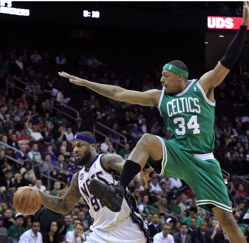 DeShawn Stevenson of the New Jersey Nets heads to the basket past Paul Pierce of the Boston Celtics during the first quarter Saturday night. The Celtics won, 94-82.