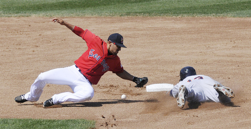 Sea Dogs second baseman Ryan Dent can't hold on to the ball as he attempts to tag Binghamton's Juan Lagares on a stolen-base attempt Sunday at Hadlock Field. Binghamton earned a split of the four-game series with a 9-2 victory.