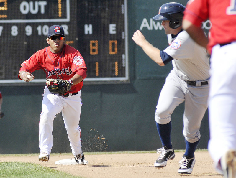 Sea Dogs shortstop Heiker Meneses chases Binghamton's Eric Campbell back to first base during a rundown Sunday. Campbell was eventually tagged out.