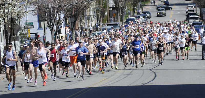 Runners take off at the start of the 83rd annual Patriots Day 5-Miler on Sunday in Portland.