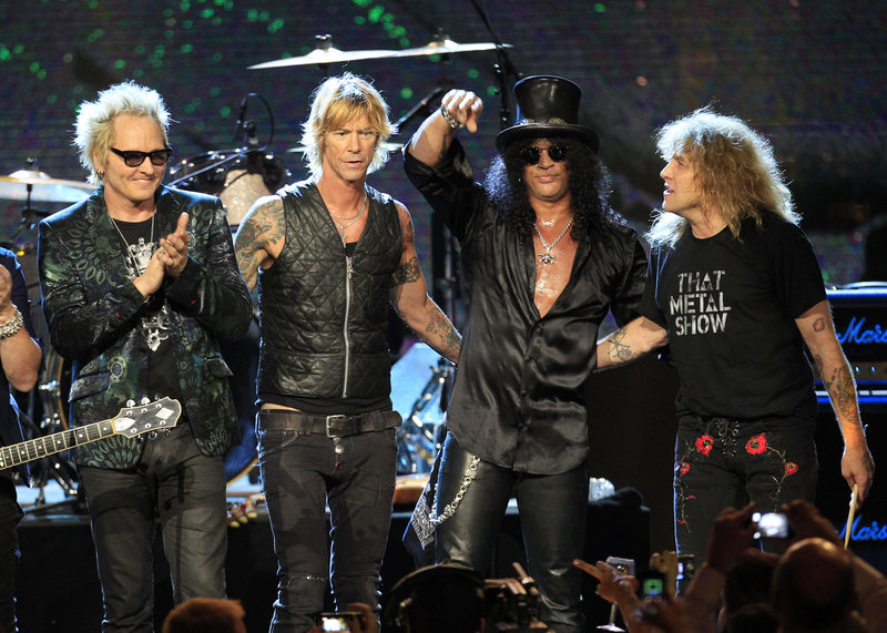 Guns N' Roses, from left, Matt Sorum, Duff McKagan, Slash and Steven Adler, are shown after their performance following induction into the Rock and Roll Hall of Fame early Sunday in Cleveland.