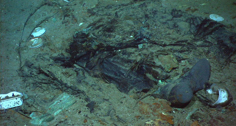 This photo provided by the Institute for Exploration, Center for Archaeological Oceanography/University of Rhode Island/NOAA Office of Ocean Exploration shows the remains of a coat and boots in the mud on the sea bed near Titanic's stern, which may be evidence of where a victim of the disaster came to rest when the famous passenger ship sank after striking an iceberg 100 years ago.