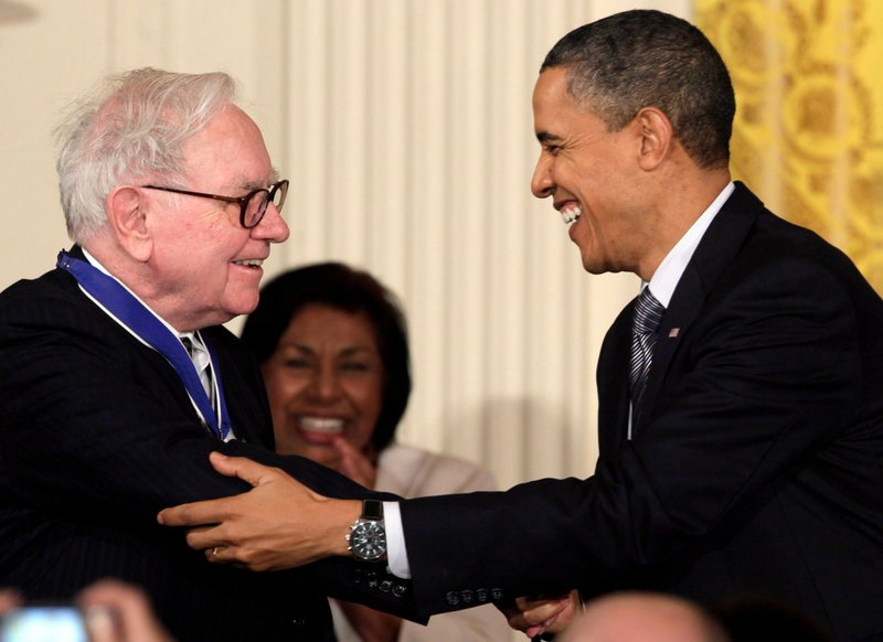 "President Obama greets Warren Buffett, after whom the so-called ""Buffett rule"" is named."