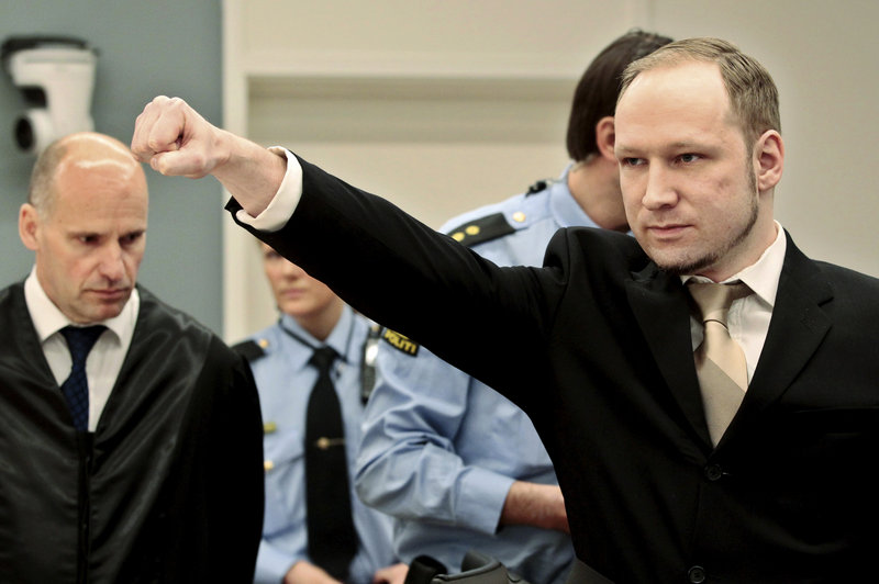 Accused mass killer Anders Behring Breivik gestures as he arrives in a courtroom in Oslo, Norway, on Monday.