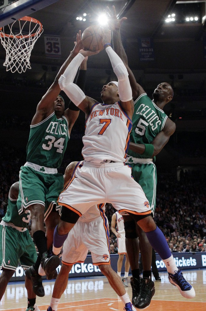 Paul Pierce, left, and Kevin Garnett of the Boston Celtics look for a way to stop Carmelo Anthony, who had 35 points Tuesday for the Knicks.