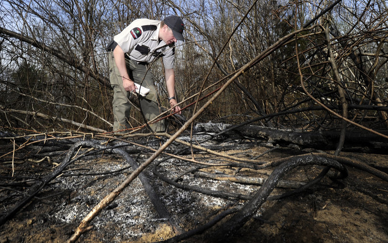 Forest Ranger Matthew Bennett investigates one of two fires that occurred Wednesday afternoon in South Portland's Hinckley Park. Wednesday was a Class 4 rating day – the second-highest level of fire danger – for the entire state.