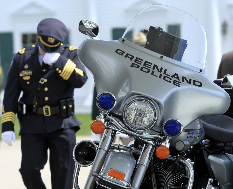 Maloney's motorcycle was displayed outside the funeral home where a wake was held.