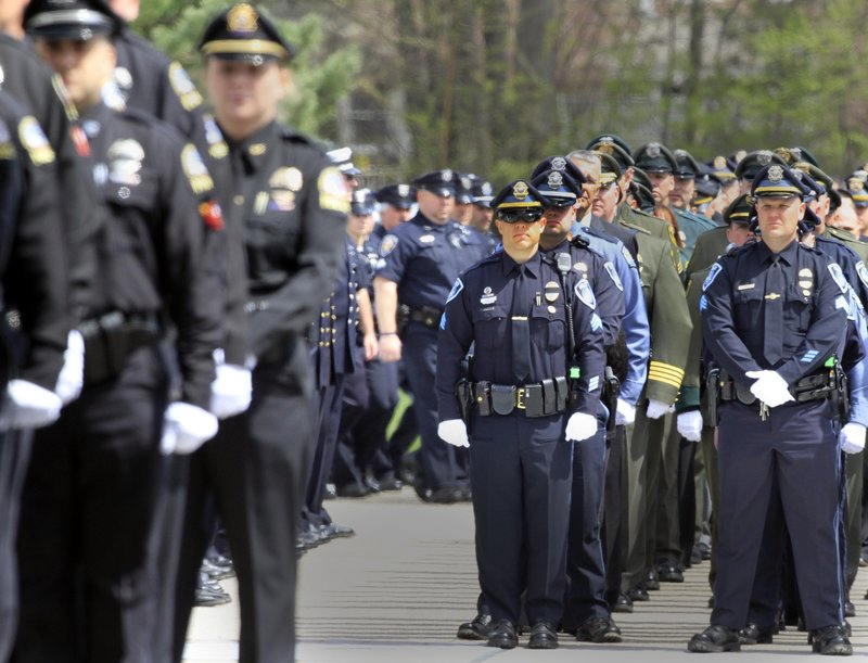 Hundreds of law enforcement officers line up Wednesday to pay their respects to Greenland, N.H., Police Chief Michael Maloney, who was killed last week while trying to serve a warrant.