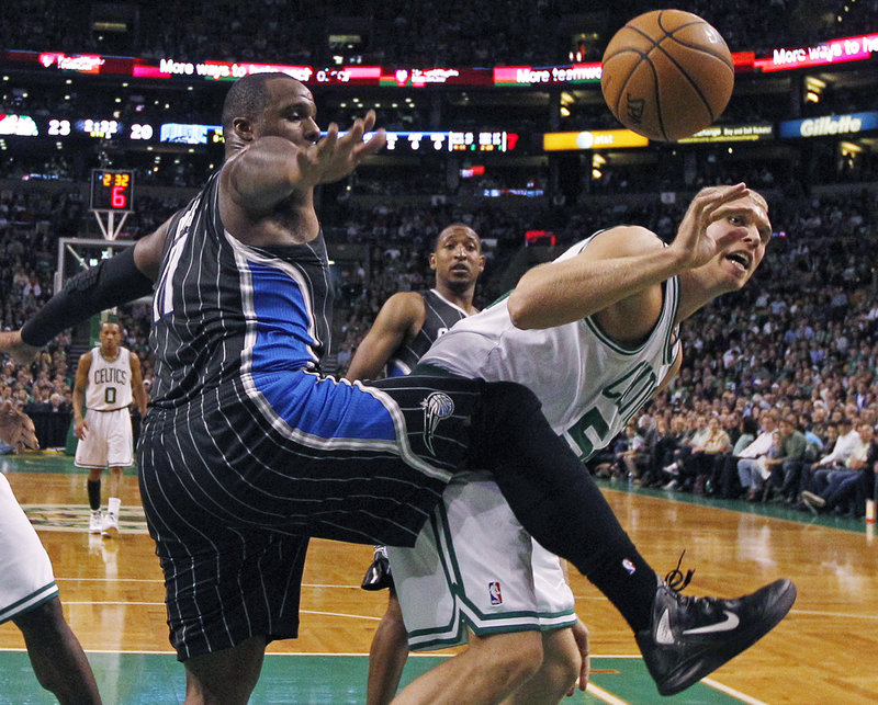 Glen Davis of the Orlando Magic, left, and Greg Stiemsma of the Boston Celtics compete for a rebound Wednesday night during the Celtics' 102-98 victory at home.