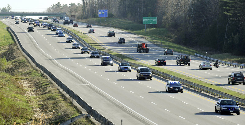 Gathering in Scarborough, law enforcement officers from state and local police departments and other agencies in Maine form a procession on the Maine Turnpike on Thursday to attend the funeral of Greenland Police Chief Michael Maloney in Hampton, N.H.