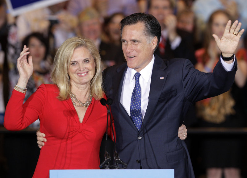 Former Massachusetts Gov. Mitt Romney and his wife, Ann, wave as they leave an election night rally in Schaumburg, Ill., after winning the Illinois primary.