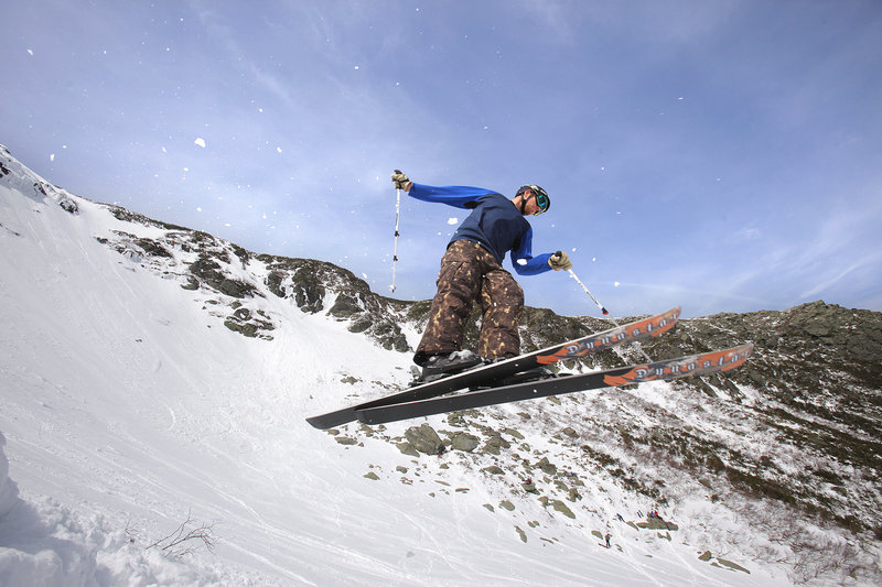 Eric Schaefer of Connecticut takes to the air after launching off a makeshift jump in Tuckerman Ravine in New Hampshire last week.