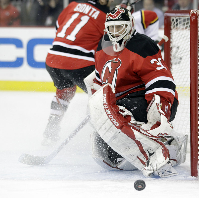 Martin Brodeur keeps his eyes on the puck during his 26-save effort as the Devils beat the Panthers 4-0 to tie their playoff series 2-2. It was Brodeur's 24th playoff shutout.