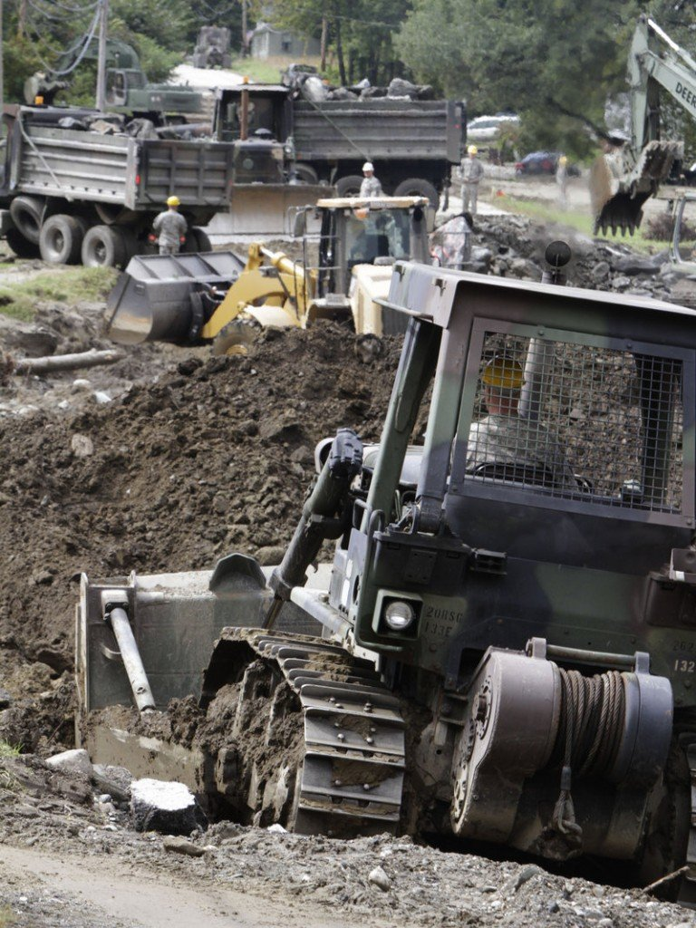 Engineers from the Maine National Guard work on rebuilding Vermont Route 107 in Stockbridge, Vt., last year after widespread flooding caused by Tropical Storm Irene.