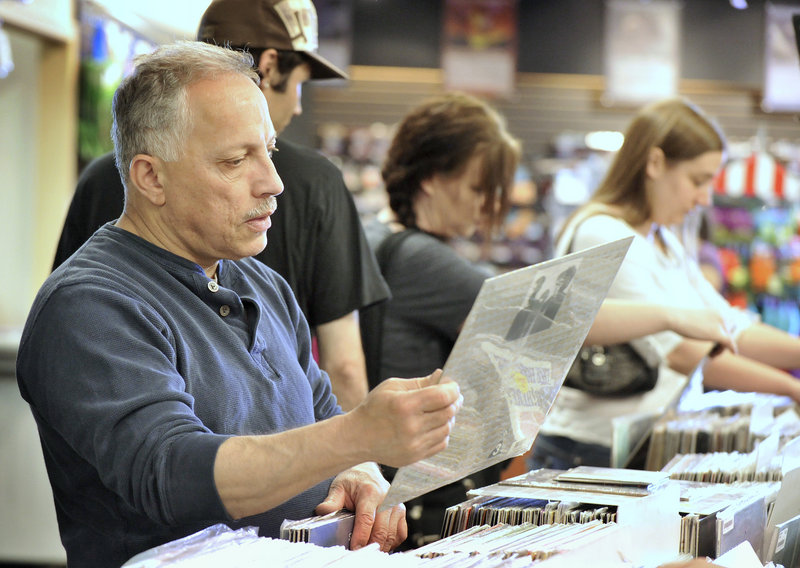 Pete Maestre of Sanford looks through the vinyl selection Saturday at Bull Moose, where he found a 1971 Ugly Custard, The Hollies' second album and a silver vinyl Metallica release.