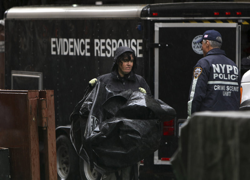 Investigators work at a building at Wooster and Prince streets in Manhattan on Sunday during the latest search for traces of 6-year-old Etan Patz, who vanished in 1979. Heavy rains expected in the region halted the search Sunday afternoon, but work in the building is expected to resume today.