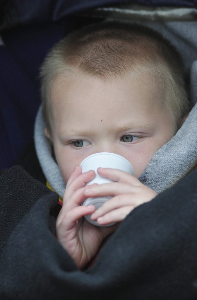Jacob Tuttle, 2, of Portland, samples a smoothie.