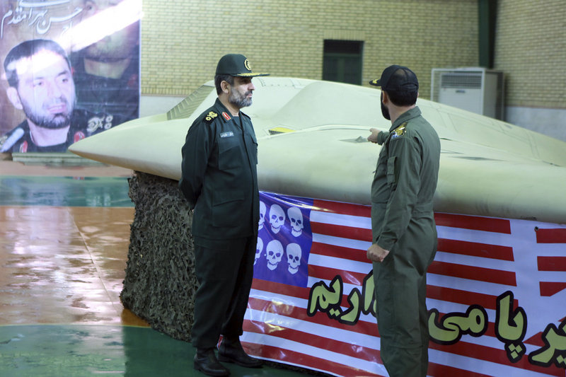 Photo released on Dec. 8, 2011 by Iran's Revolutionary Guards claims to show Gen. Amir Ali Hajizadeh, left, listening to an unidentified colonel as he points to a U.S. RQ-170 Sentinel drone that Tehran says was downed by its forces. Iran said Sunday that it is building a copy of the drone.