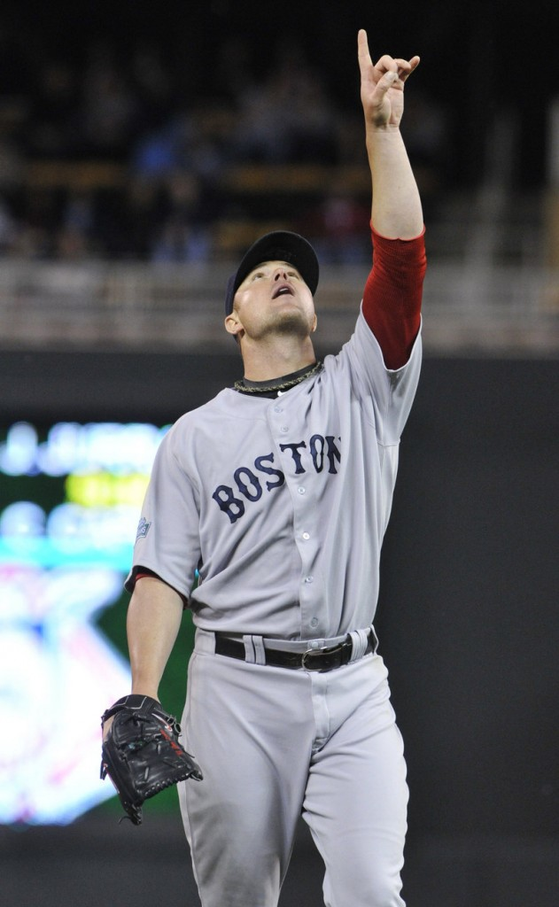 Red Sox pitcher Jon Lester points to a popup off the bat of Justin Morneau in the sixth inning. Lester gave up five runs in seven innings.